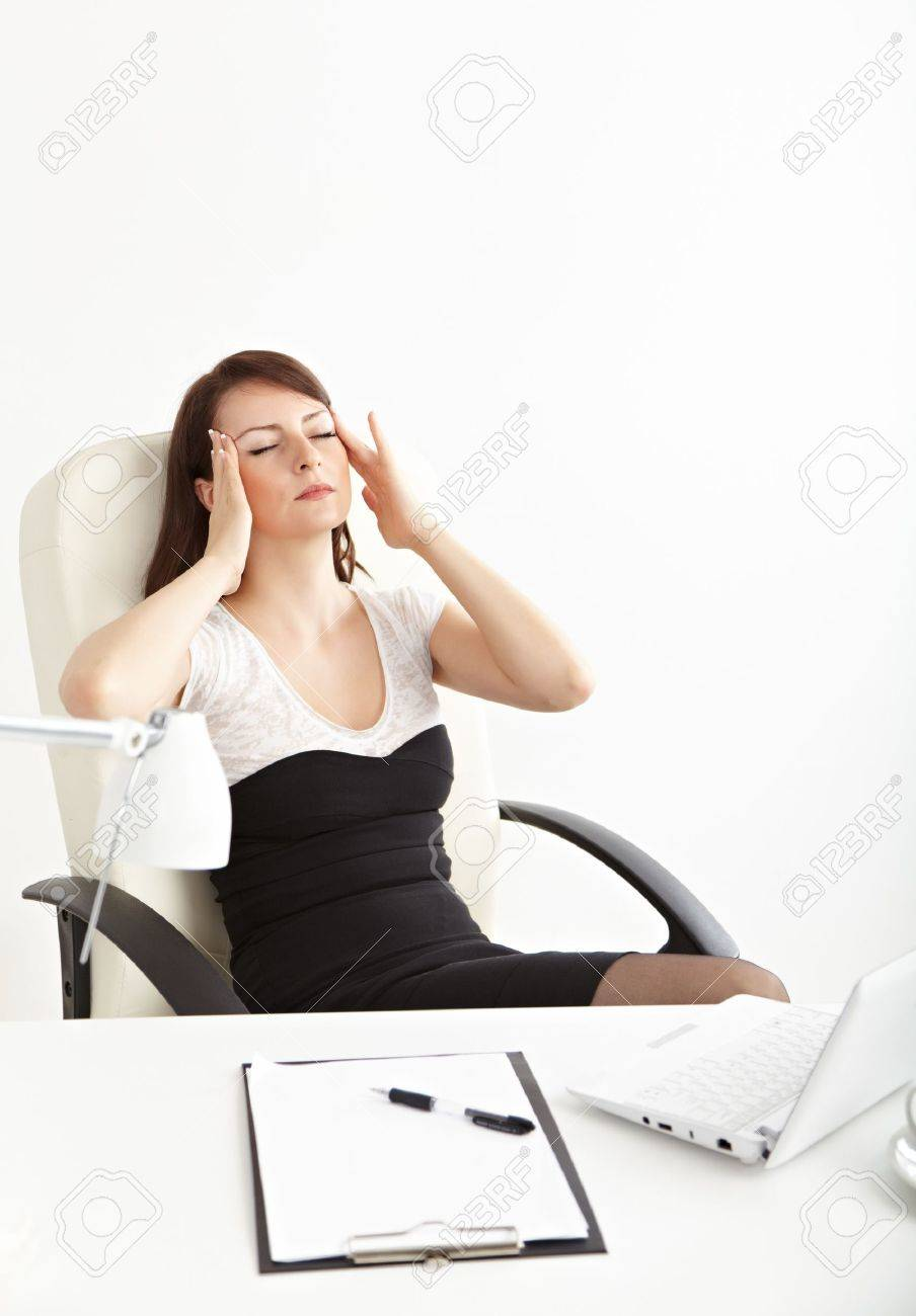Tired business woman working on her workspace Stock Photo - 14510064