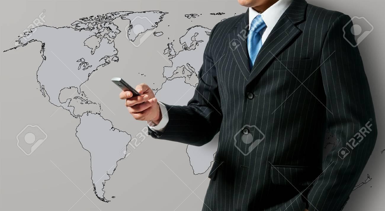 Businessman holding mobile phone Stock Photo - 15154561