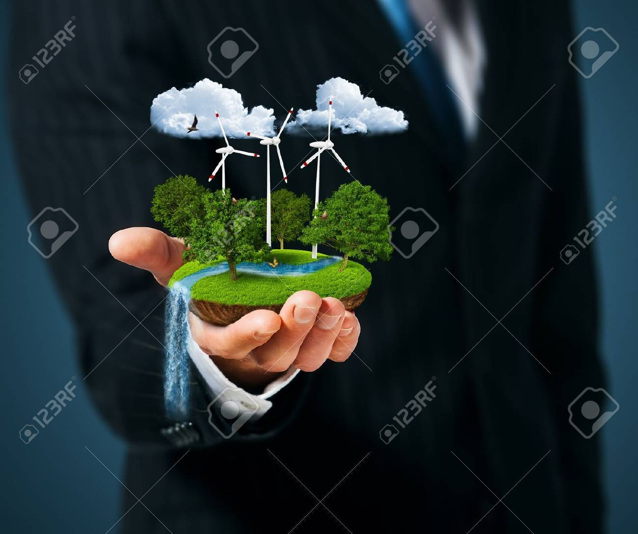 Man holding a green meadow with windmills Stock Photo - 15154559