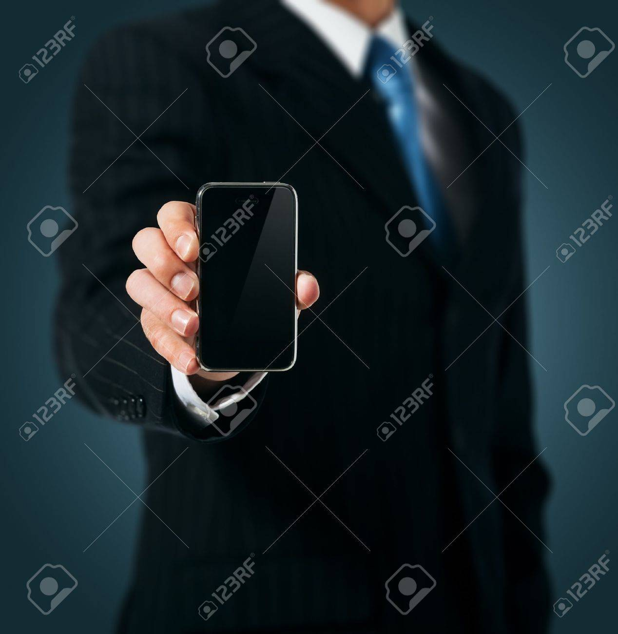 Businessman holding mobile phone Stock Photo - 15154564