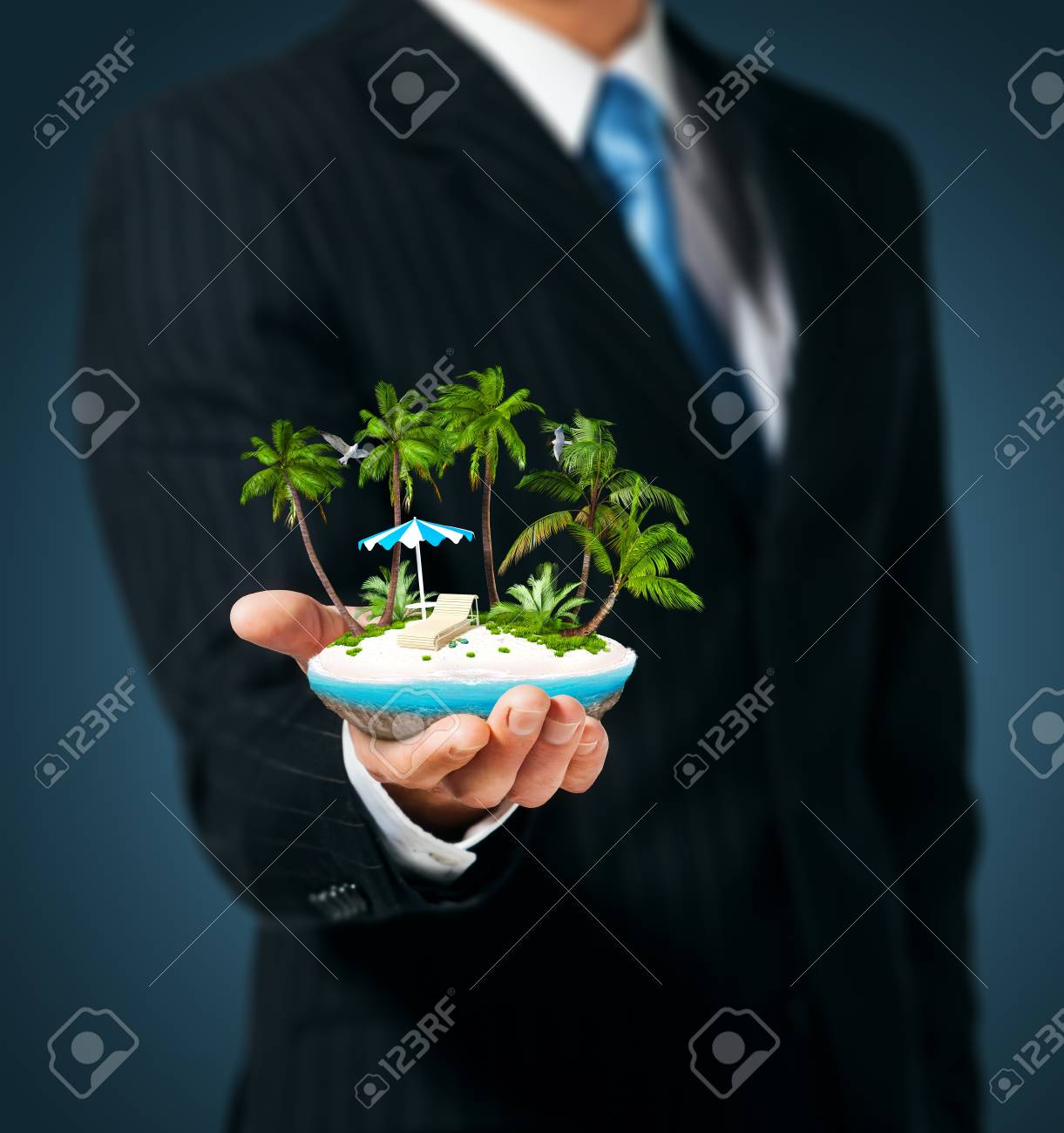 Man holding in  hand a tropical island Stock Photo - 15233512