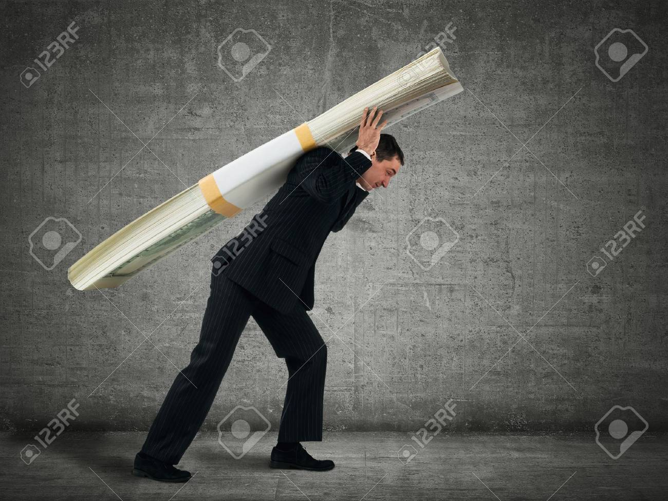 Businessman carries a stack of dollars Stock Photo - 16465282