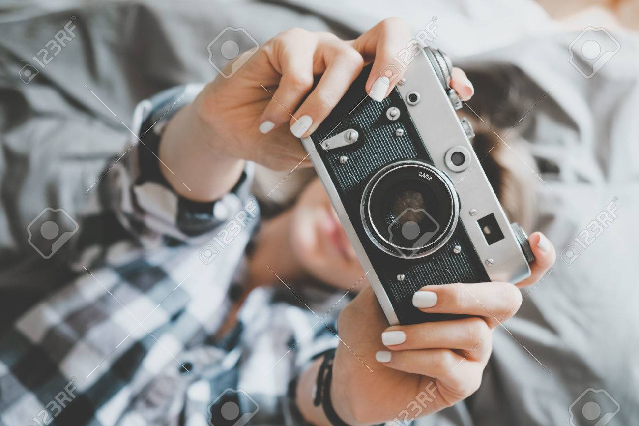 Soft photo of woman in checkered shirt taking a photo, top view point Stock Photo - 45444504