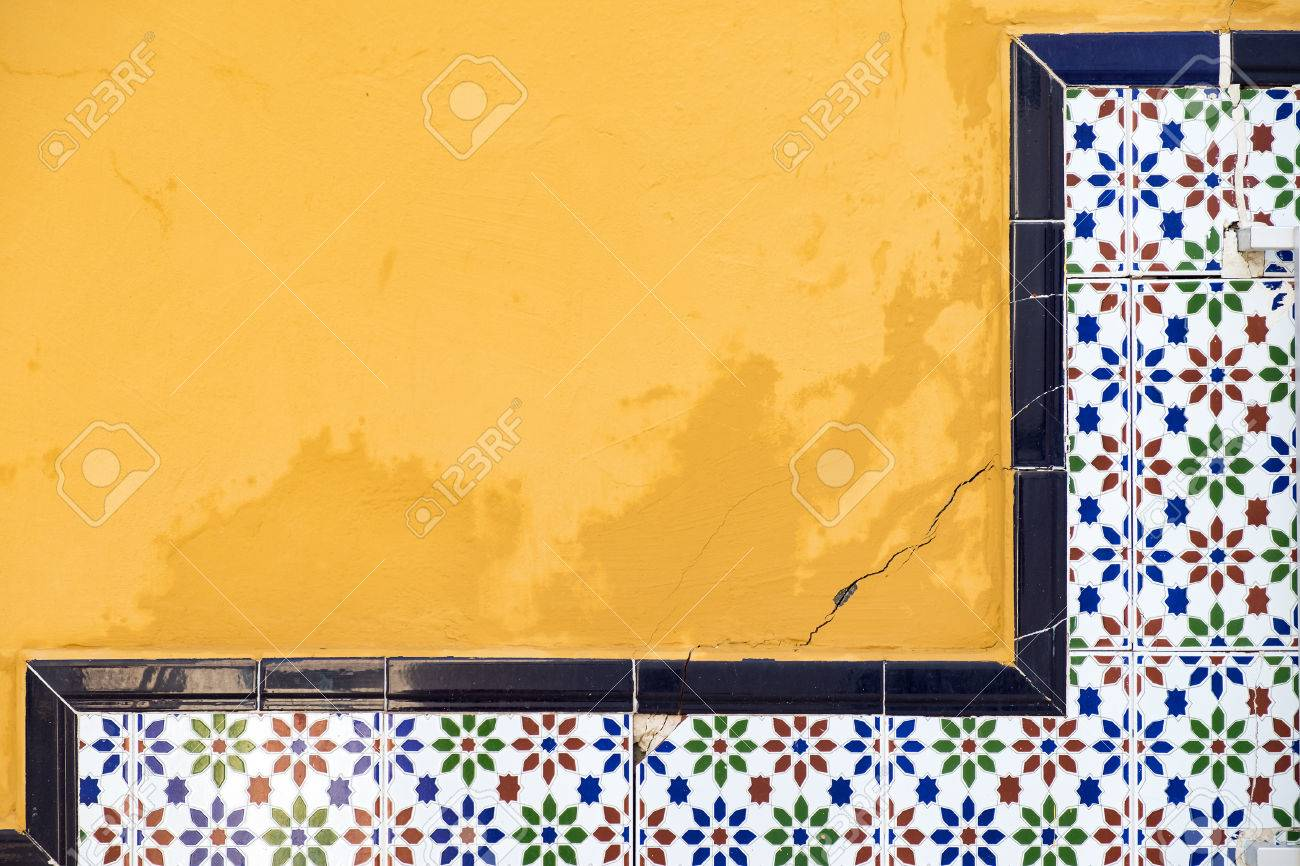 Closeur Old Yellow Wall And Colored Tiles With Traditional Spanish ...