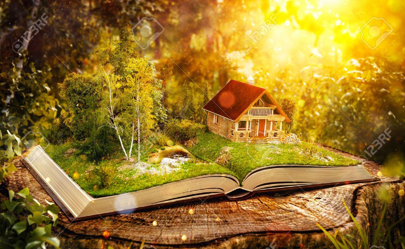 幻想的な森の開いた本のページに素敵な森でかわいい魔法ログハウス珍しい