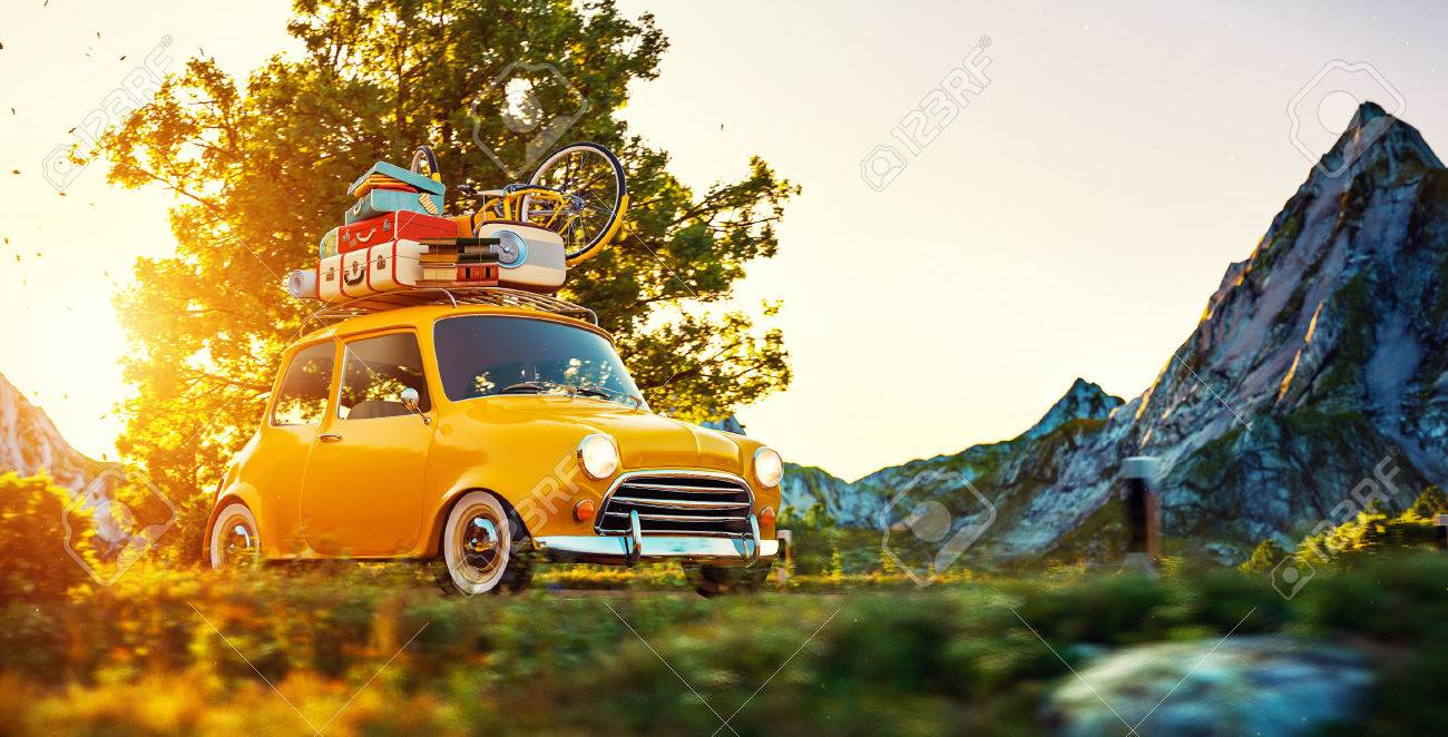 Cute little retro car with suitcases and bicycle on top goes by wonderful countryside road at sunset - 58550514
