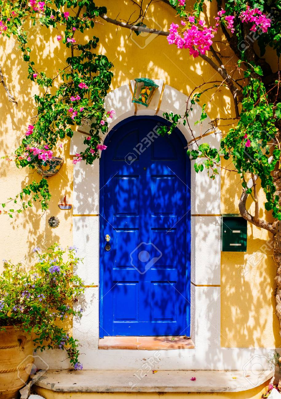 Facade of traditional Greek building with beautiful pink flowers. Greece. Kefalonia - 77821999