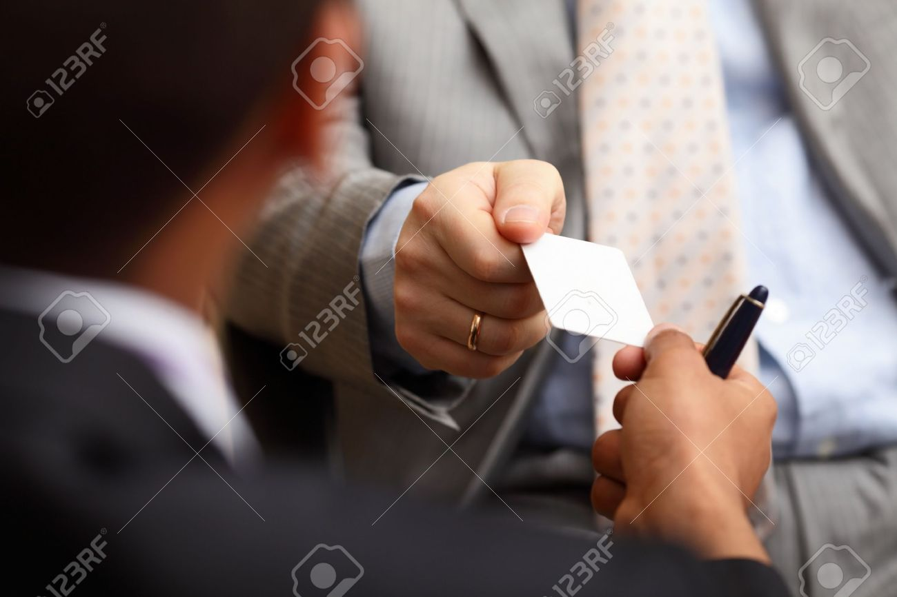 Closeup portrait of two successful business executive exchanging business card Stock Photo - 9282505