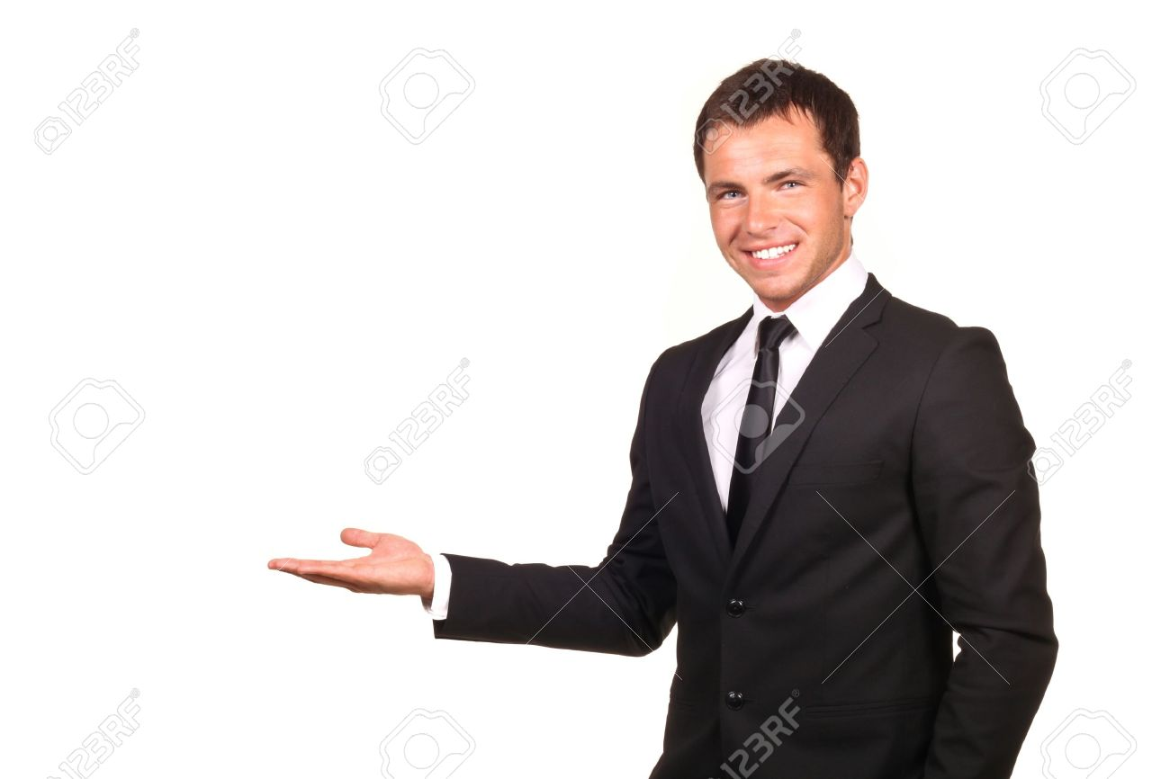 Business man presenting over a white background Stock Photo - 9281950