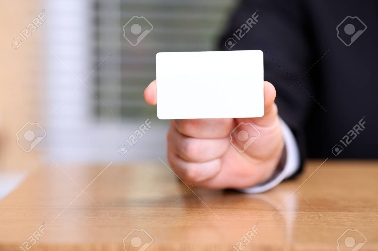 Closeup of business man holding a blank business card Stock Photo - 9282437
