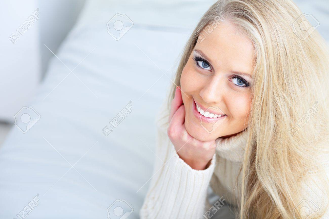 Portrait of a happy beautiful lady resting at home Stock Photo - 9283394