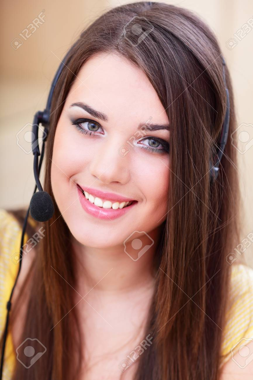Portrait of a happy young woman in headset Stock Photo - 9365470