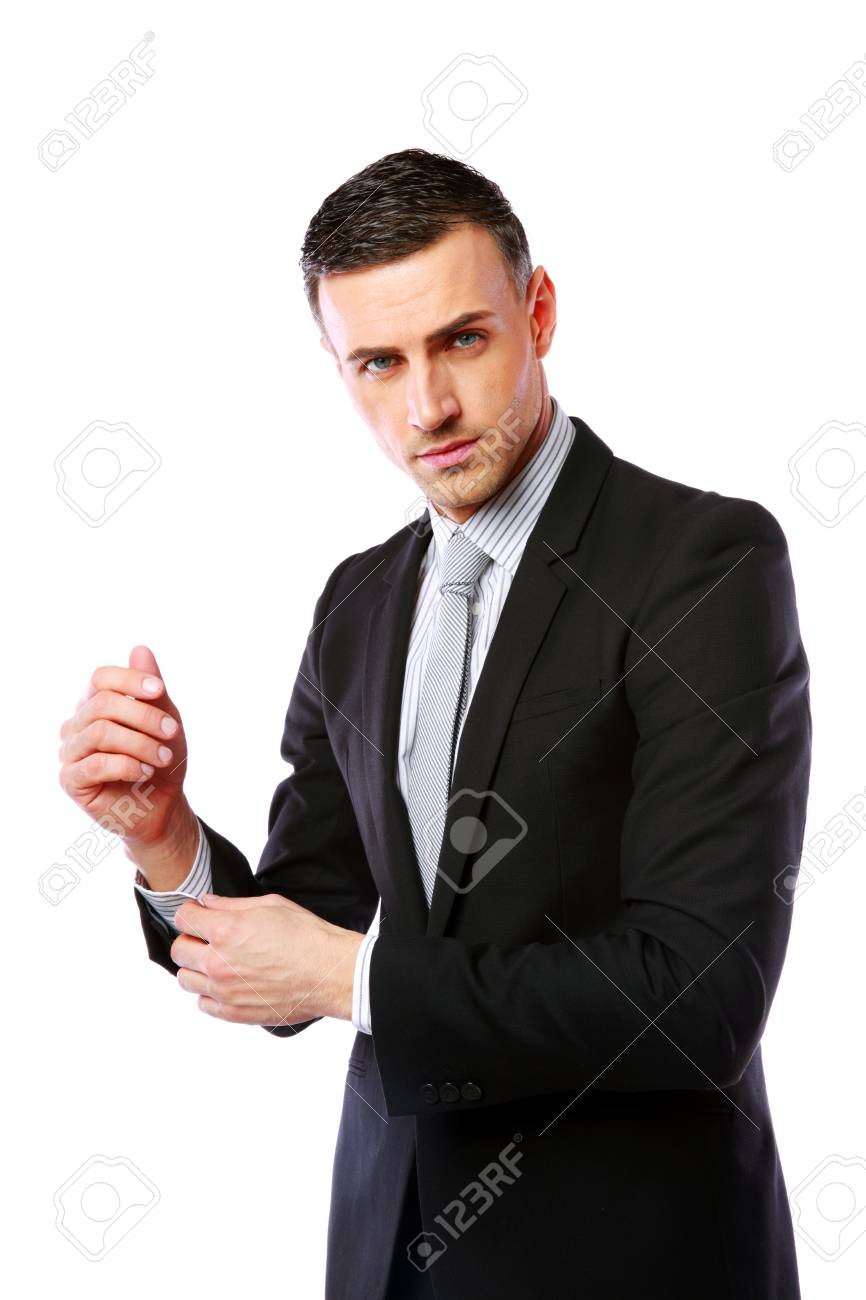 Businessman buttoning cuff sleeves isolated on a white background Stock Photo - 27240408