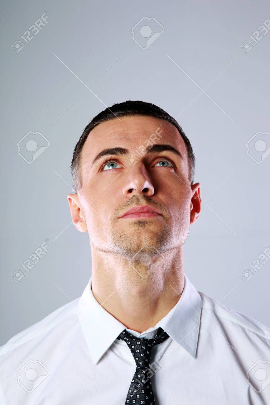 Portrait Of A Man Looking Up At Copyspace Over Gray Background Stock Photo Picture And Royalty Free Image Image 27477176 If you want to look good on the outside, you gotta take care of the inside. 123rf com