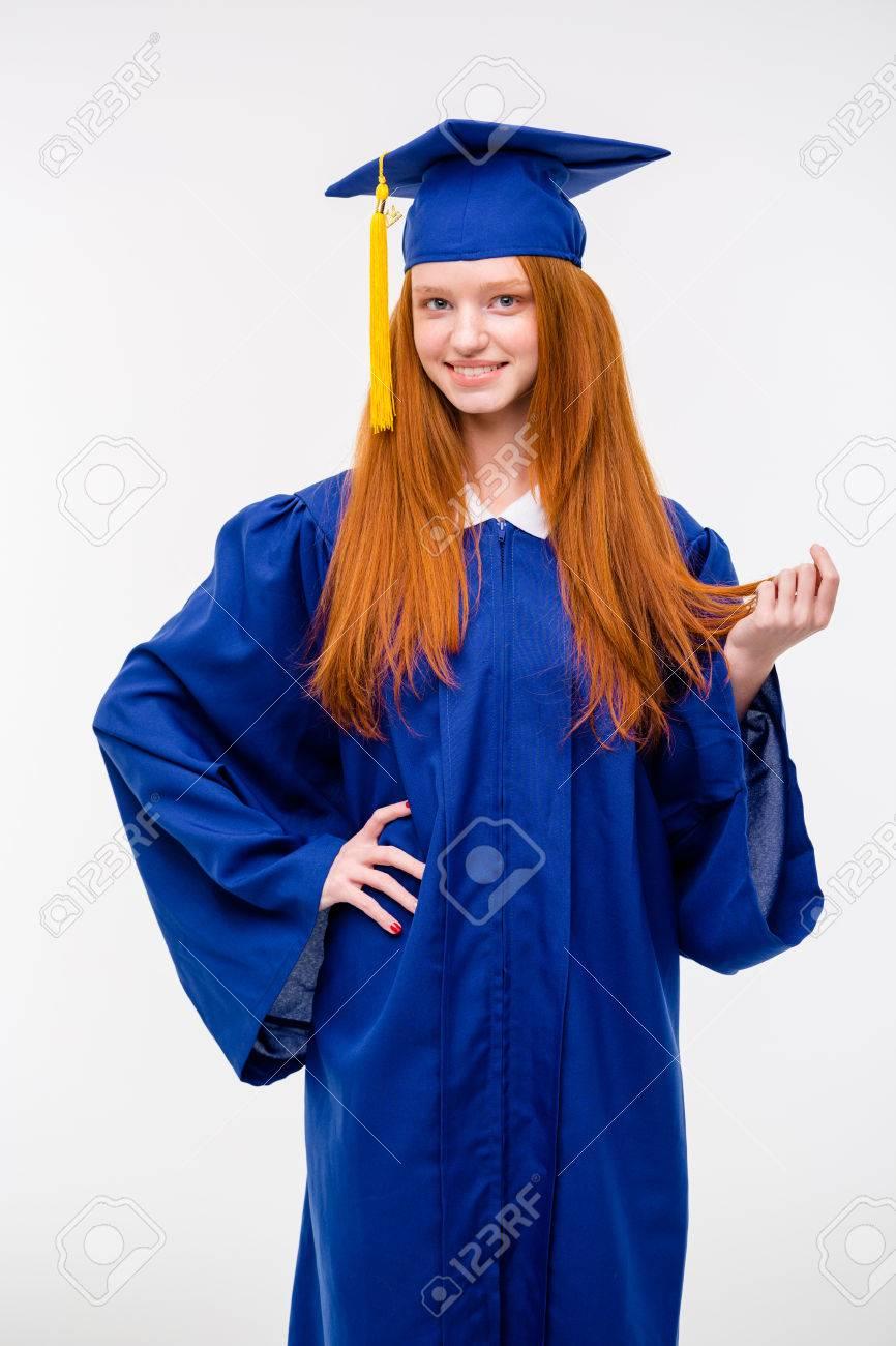 Beautiful Young Positive Redhead Woman In Blue Graduation Cap ...