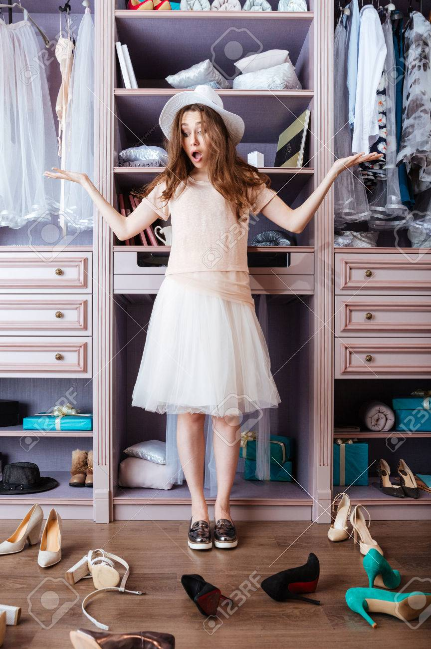 Young Pensive Beautiful Girl Choosing Shoes In Her Wardrobe Stock Photo    58207879