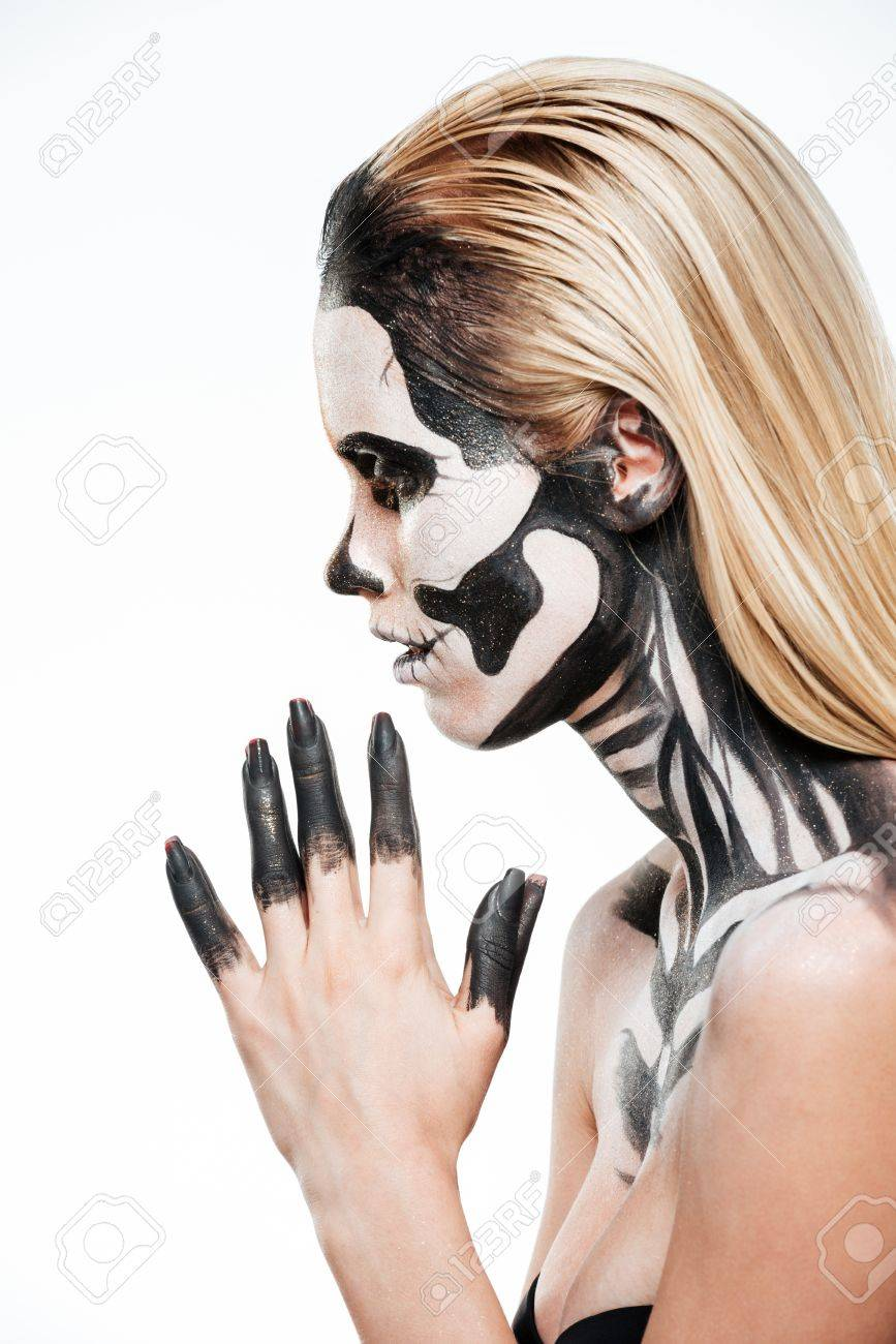 profile of girl with terrifying halloween makeup over white background stock photo 63163649