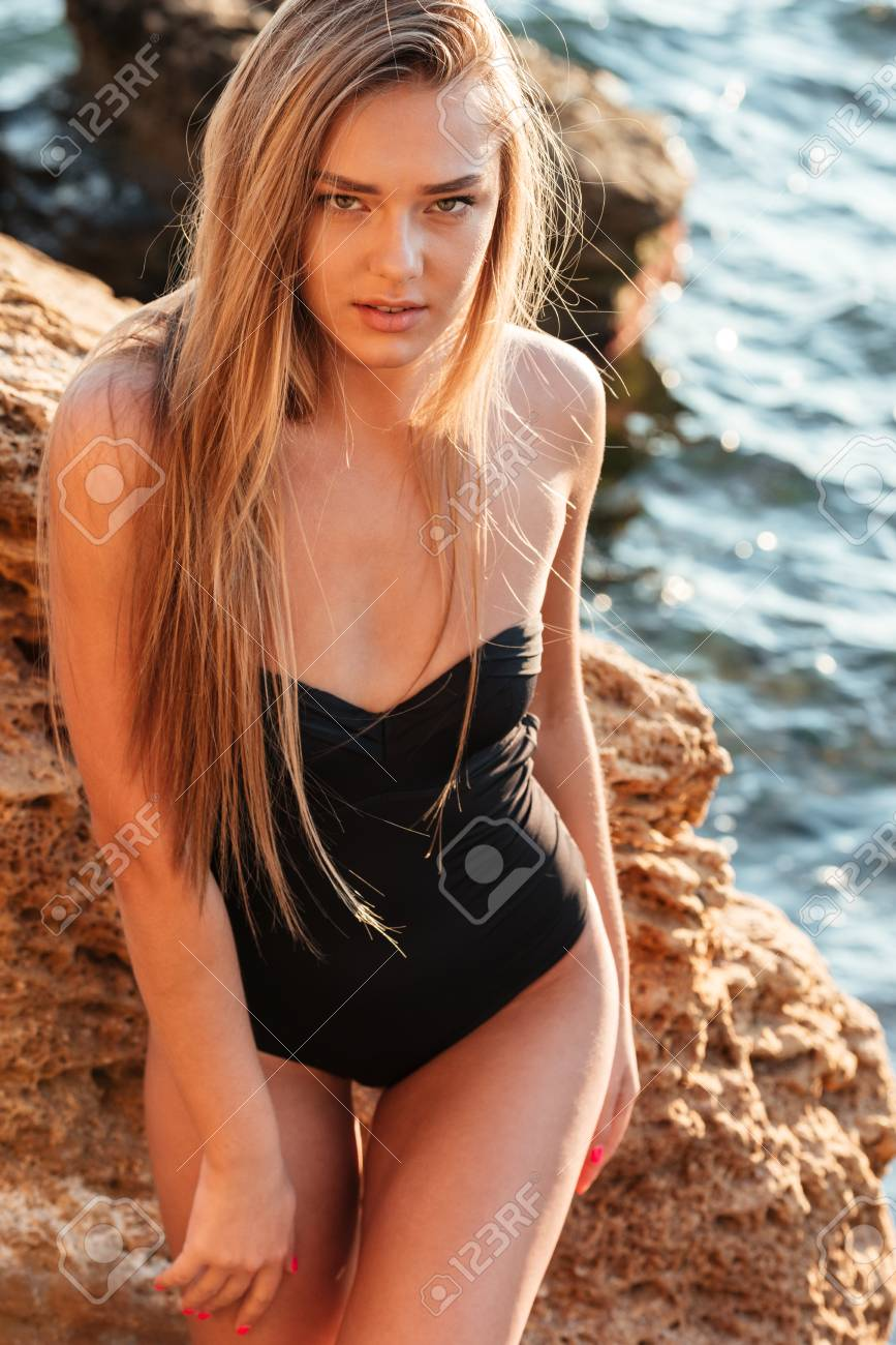 ba9fe066a4 Pretty Woman In Swimsuit. Near The Sea Stock Photo, Picture And ...