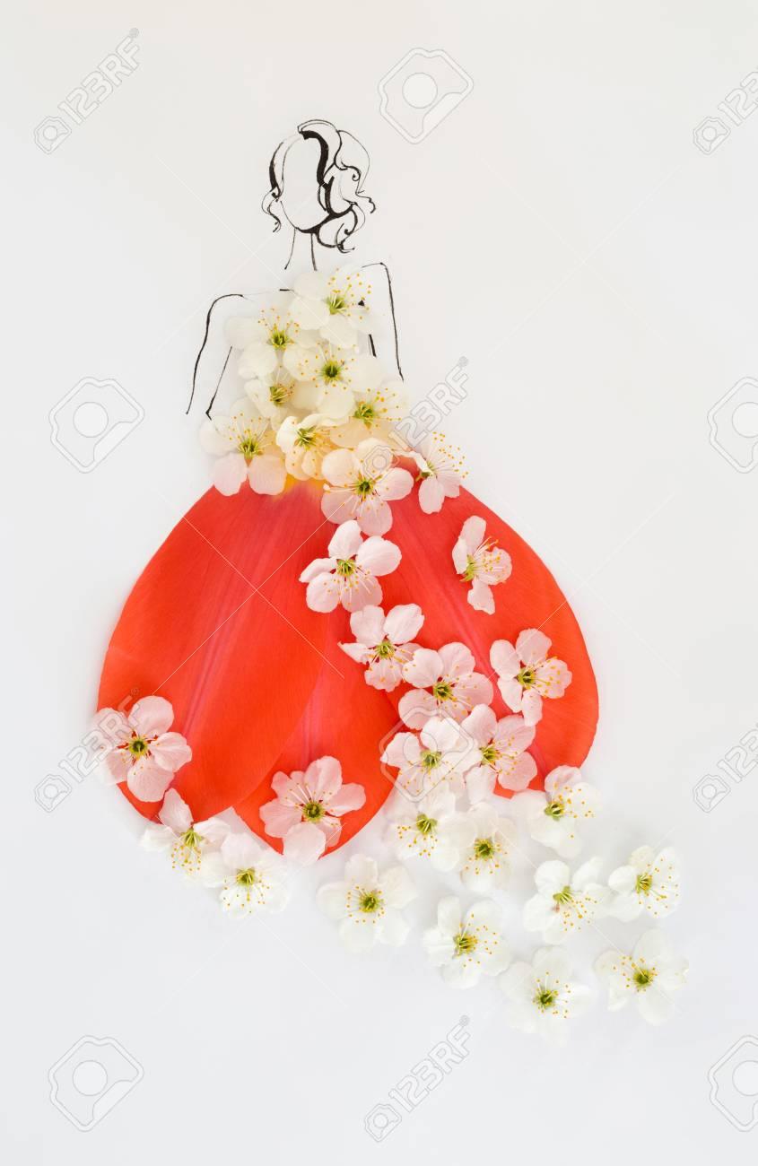 手描き女性シルエットが美しく咲く白い花と白で隔離赤いチューリップの花びらで作られたドレスを着ています ファッション イラスト の写真素材 画像素材 Image