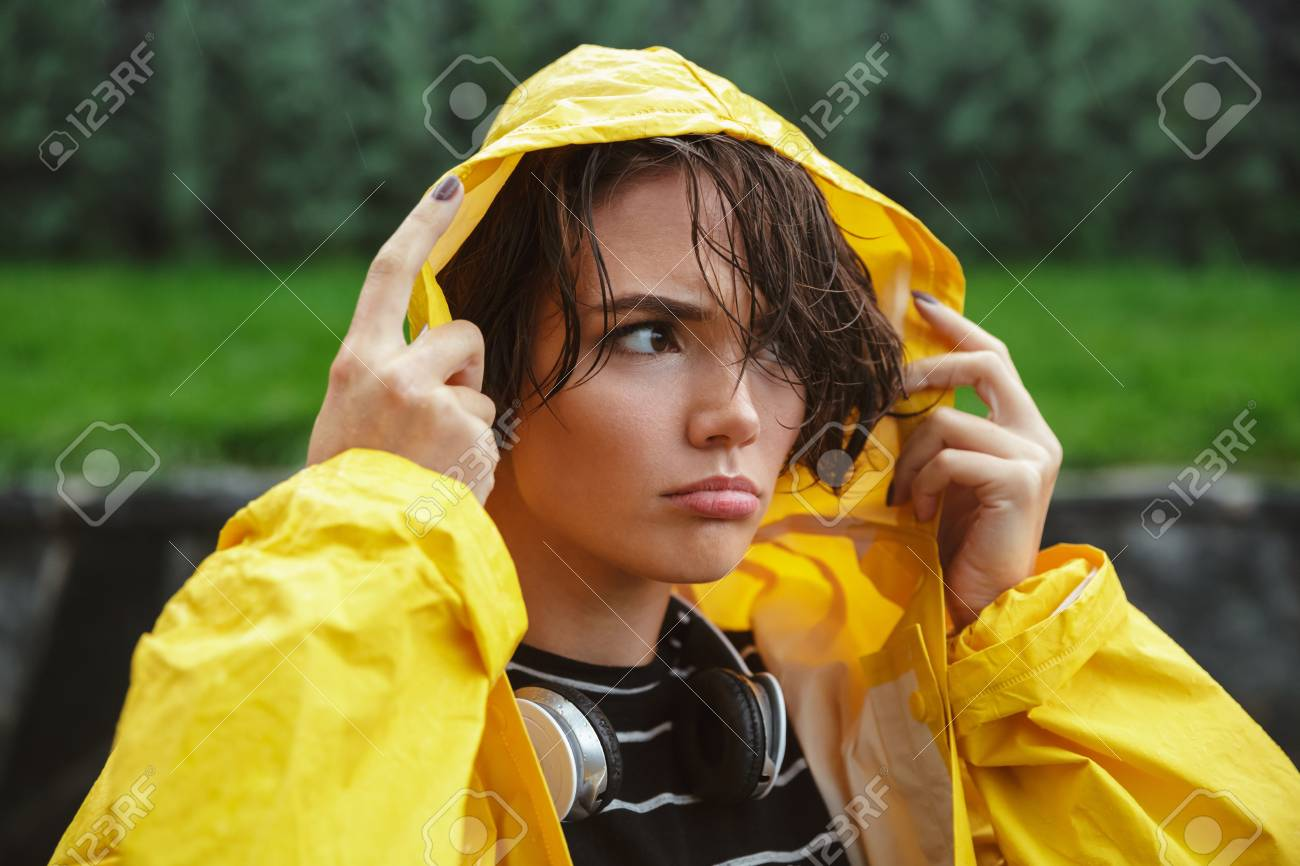 Portrait of a displeased young teenage girl wearing raincoat outdoors Stock  Photo - 88988400