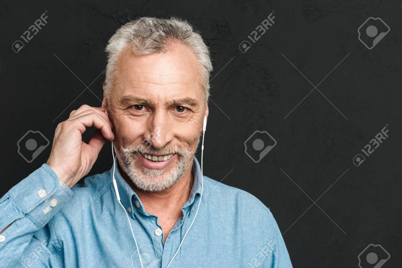 Portrait of handsome pleased mature man 60s with gray hair looking..
