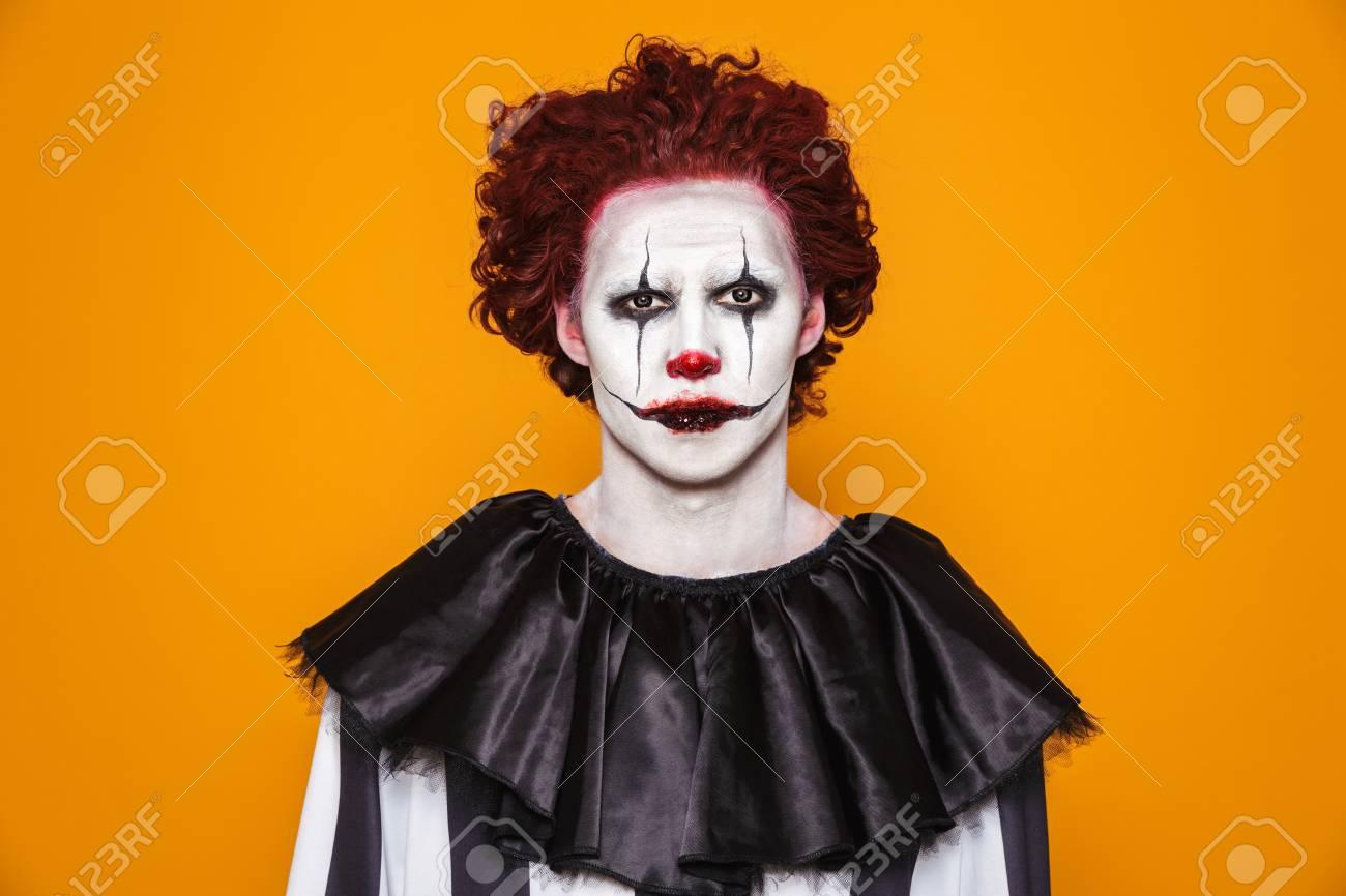 Halloween Make Up Men.Sad Clown Man 20s Wearing Black Costume And Halloween Makeup