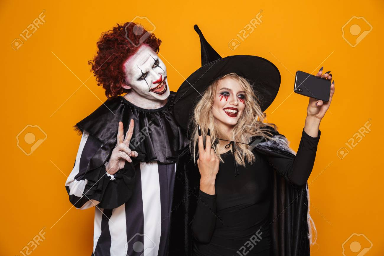 Photo Of Witch Woman And Joker Man Wearing Black Costume And