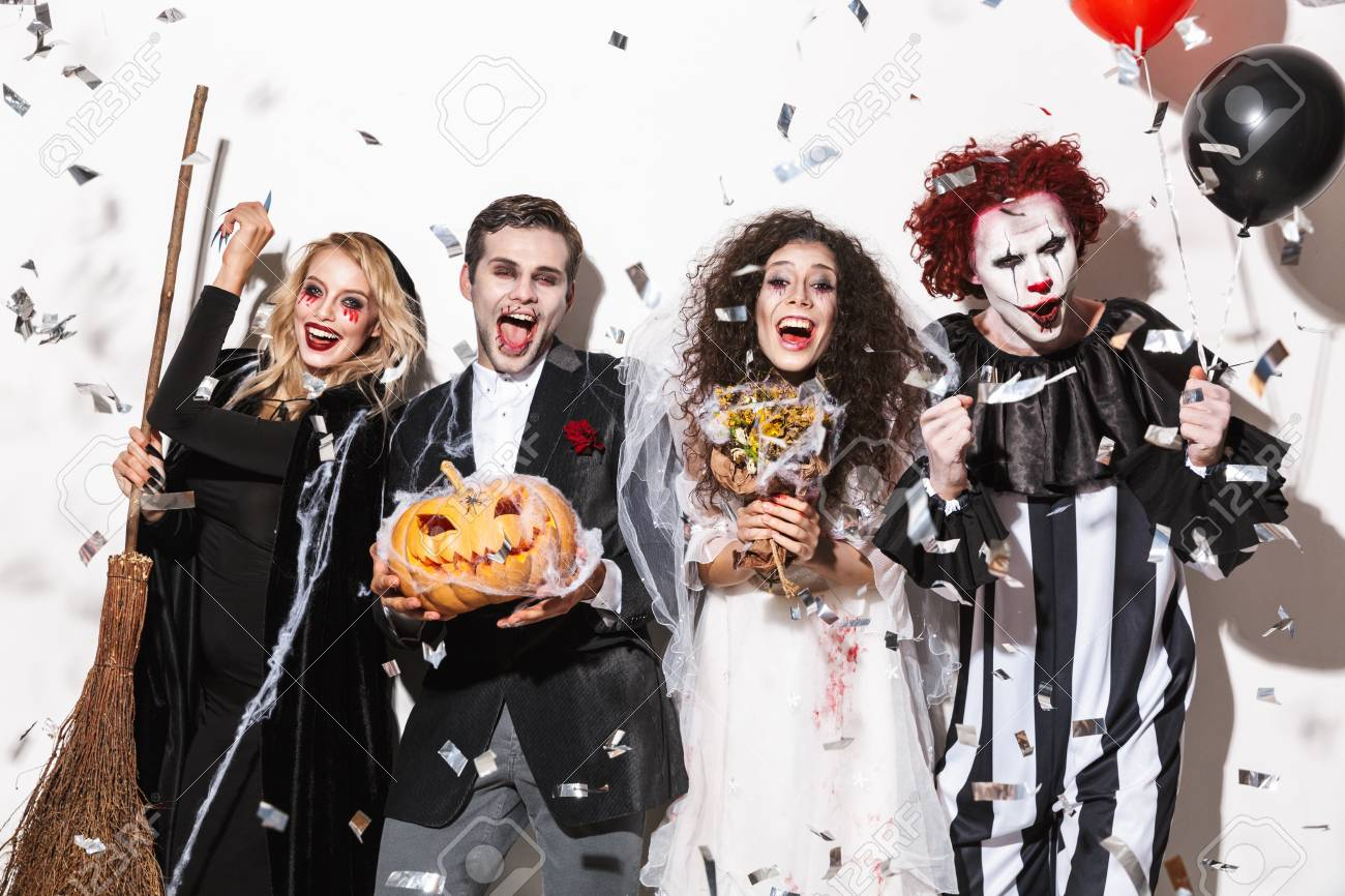 Halloween Group Costumes Scary.Group Of Cheerful Friends Dressed In Scary Costumes Celebrating
