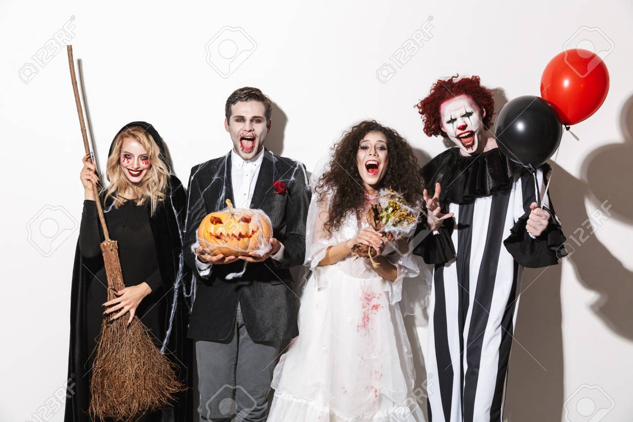 Halloween Group Costumes Scary.Group Of Excited Friends Dressed In Scary Costumes Celebrating