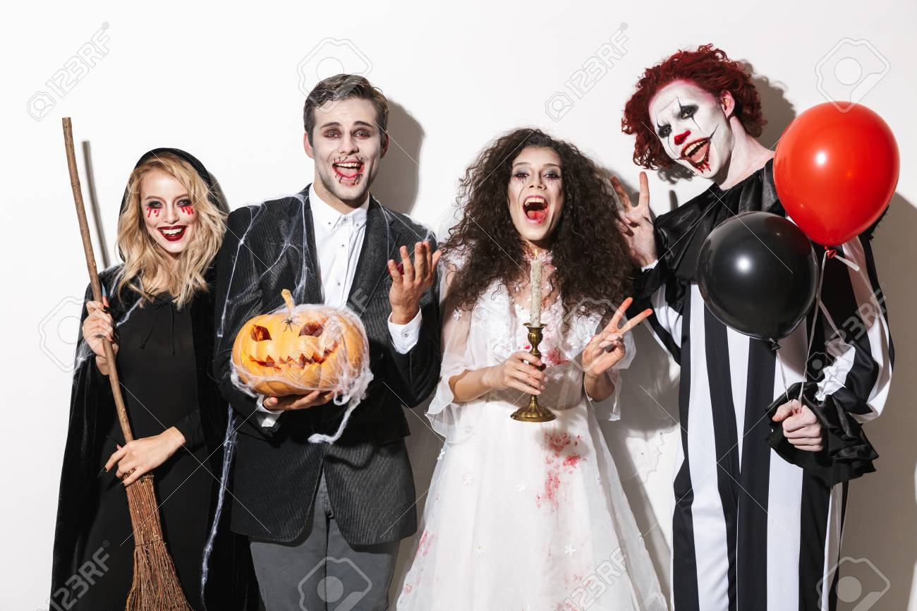 Halloween Group Costumes Scary.Group Of Laughing Friends Dressed In Scary Costumes Celebrating