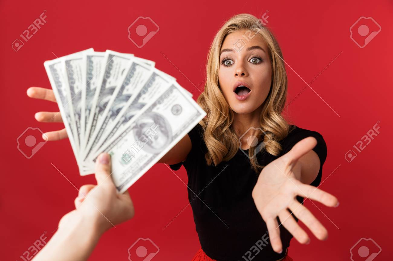 Image Of Young Excited Shocked Woman Looking At Money Which Someone