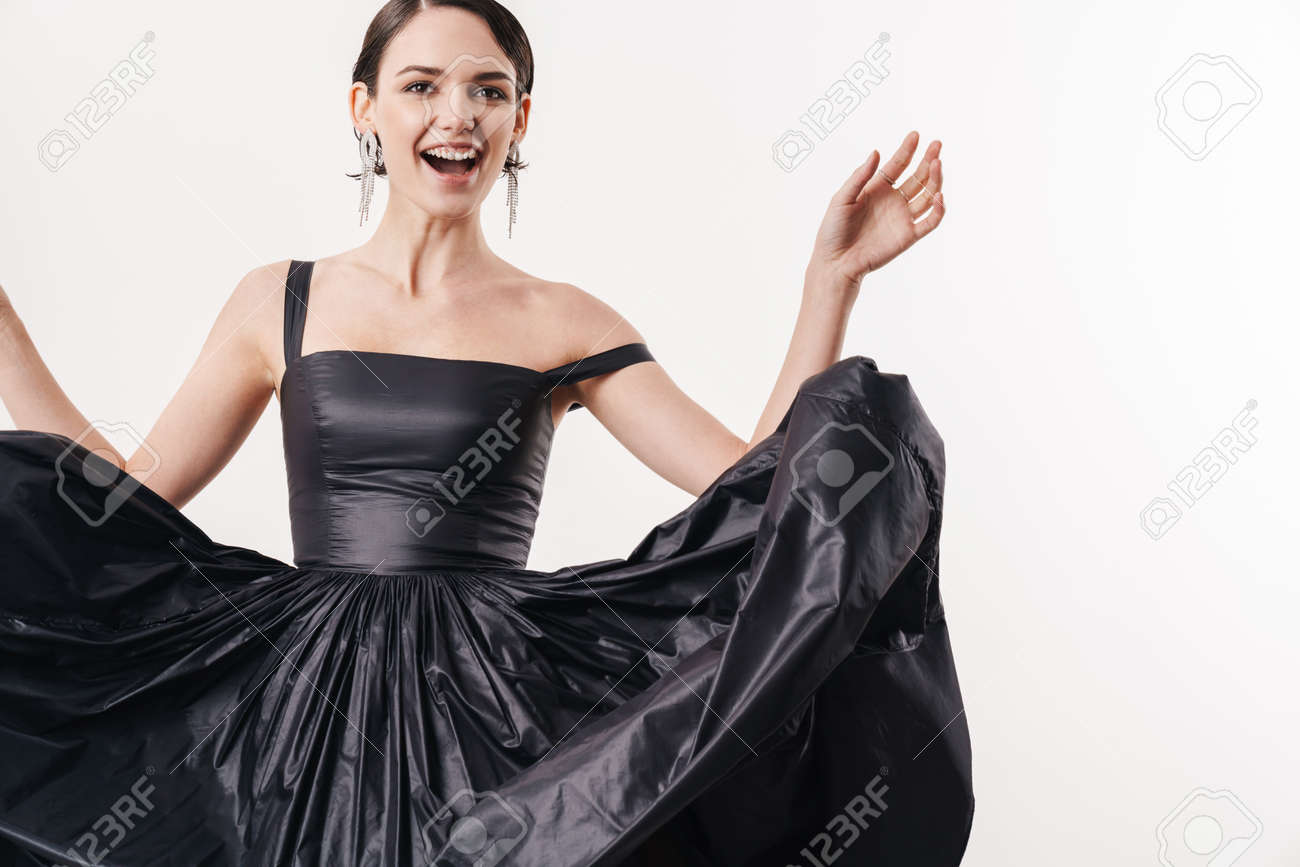 Image of pretty brunette young woman wearing dress smiling at camera isolated over white background - 146689258