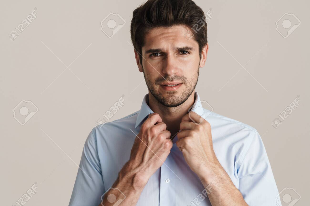 Portrait of unshaven displeased man posing and looking at camera isolated over white background - 152579457