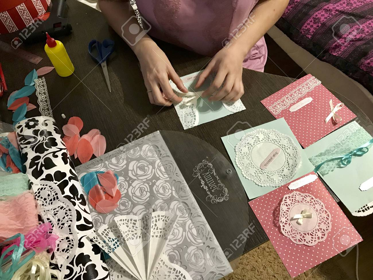 The girl is engaged in making greeting cards at home using paper stock photo the girl is engaged in making greeting cards at home using paper lace braid and other materials m4hsunfo