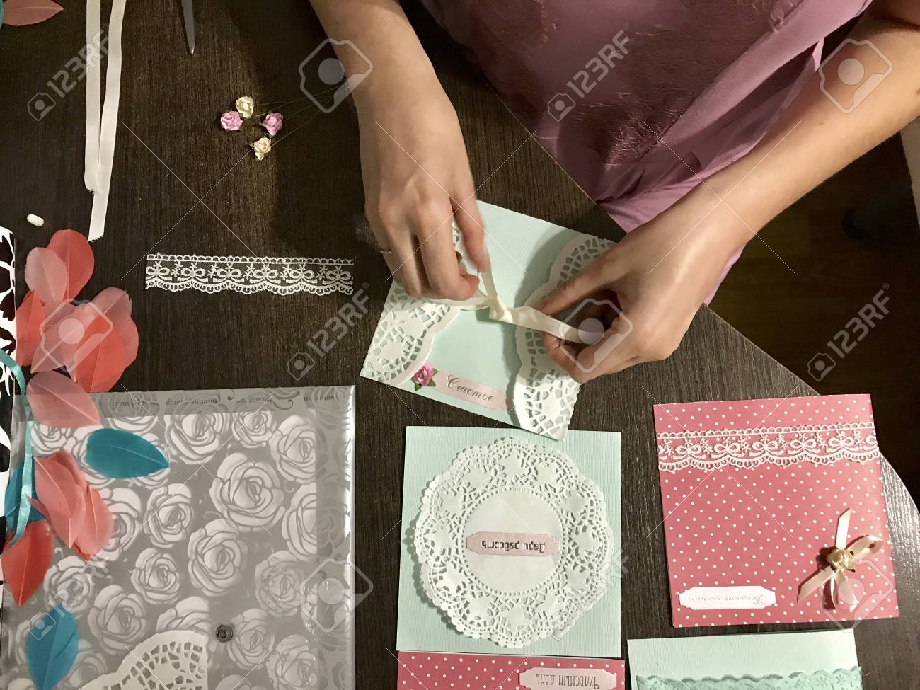 The Girl Is Engaged In Making Greeting Cards At Home Using Paper