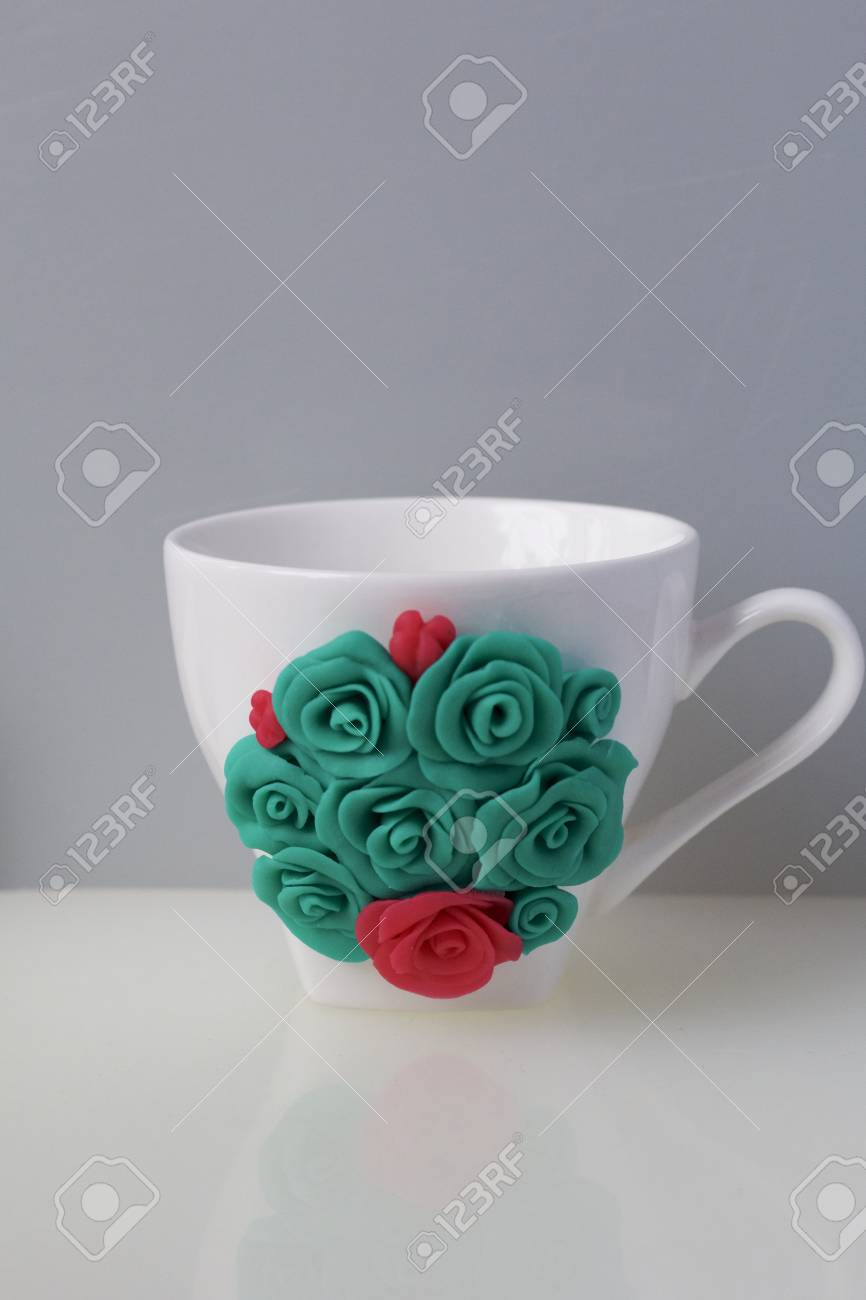 Mug Decorated With Flowers Made Of Polymer Clay Crafts From Stock Photo Picture And Royalty Free Image Image 117066494