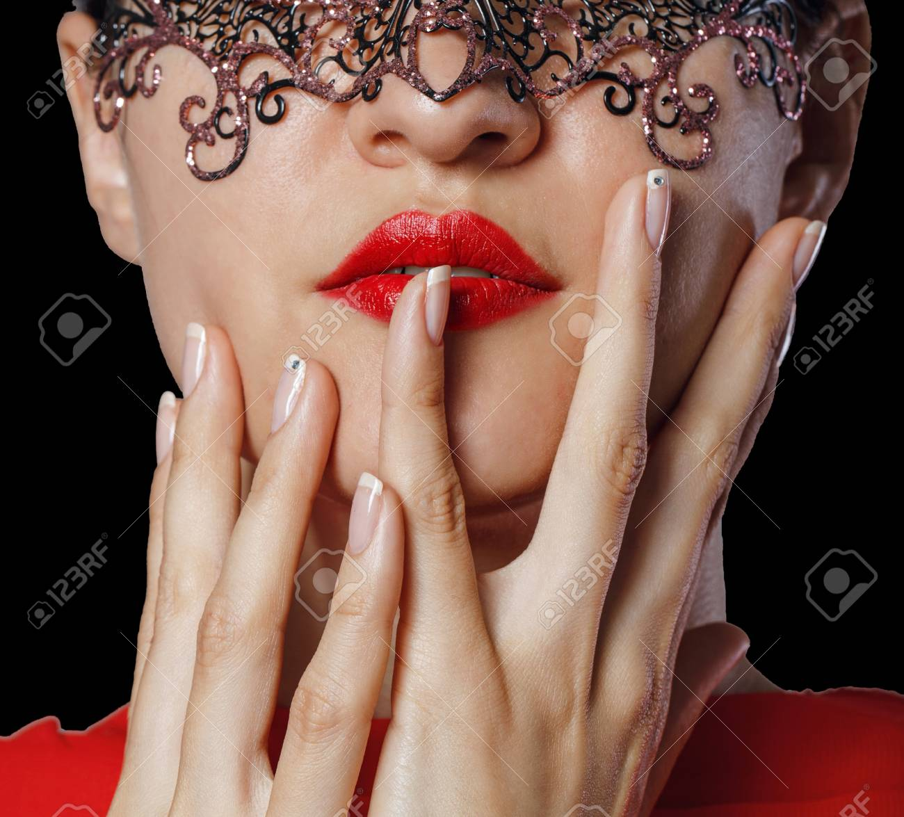 Girl in a Venetian masquerade mask isolated on a black background Stock Photo - 21305199