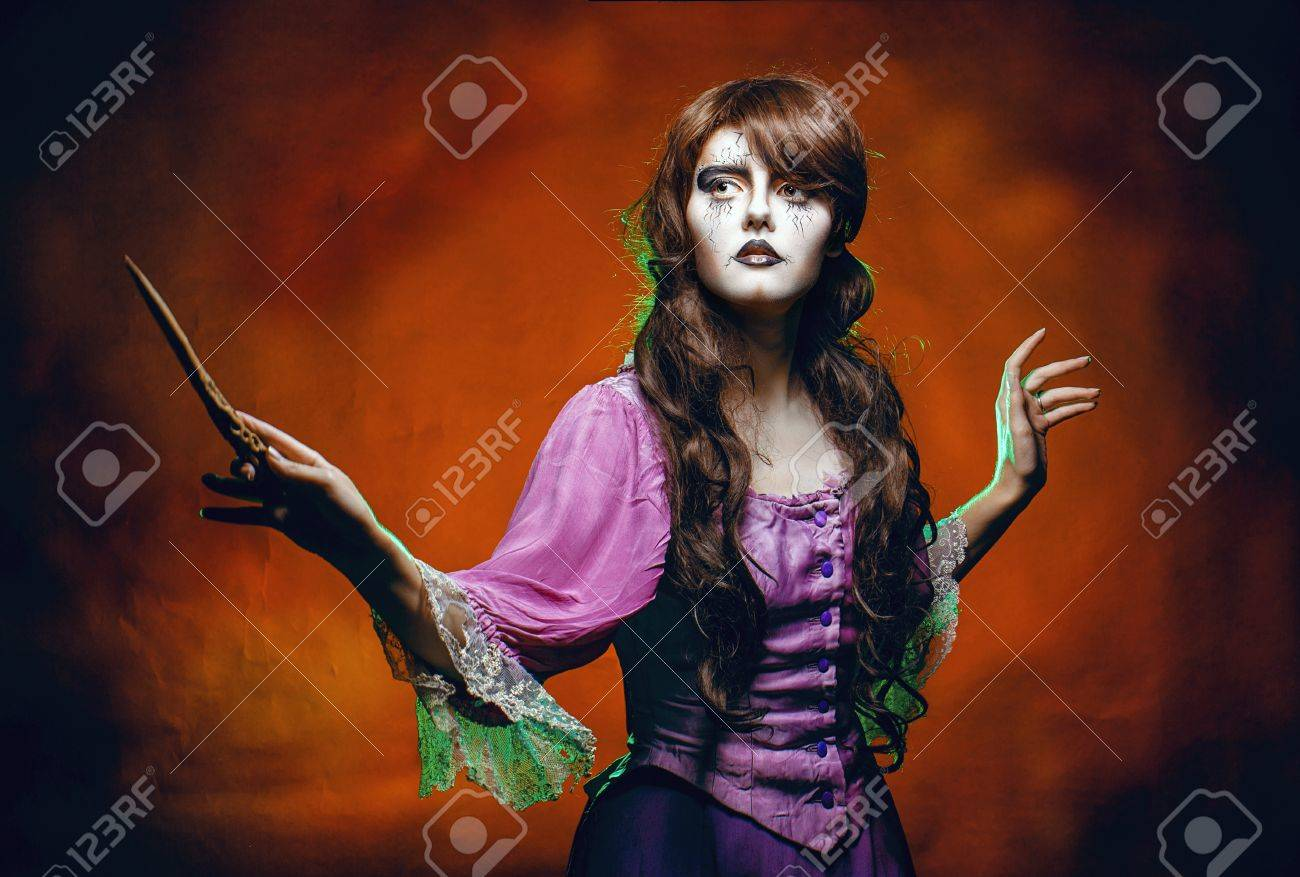 Witch casts a spell with a magic wand for halloween Stock Photo - 22168516