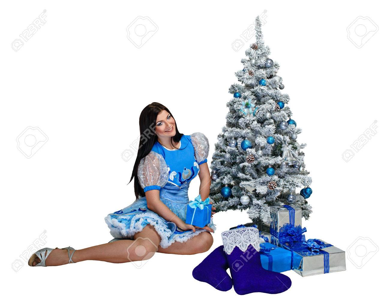 Attractive young girl sitting near Christmas tree and gifts Stock Photo - 24181091