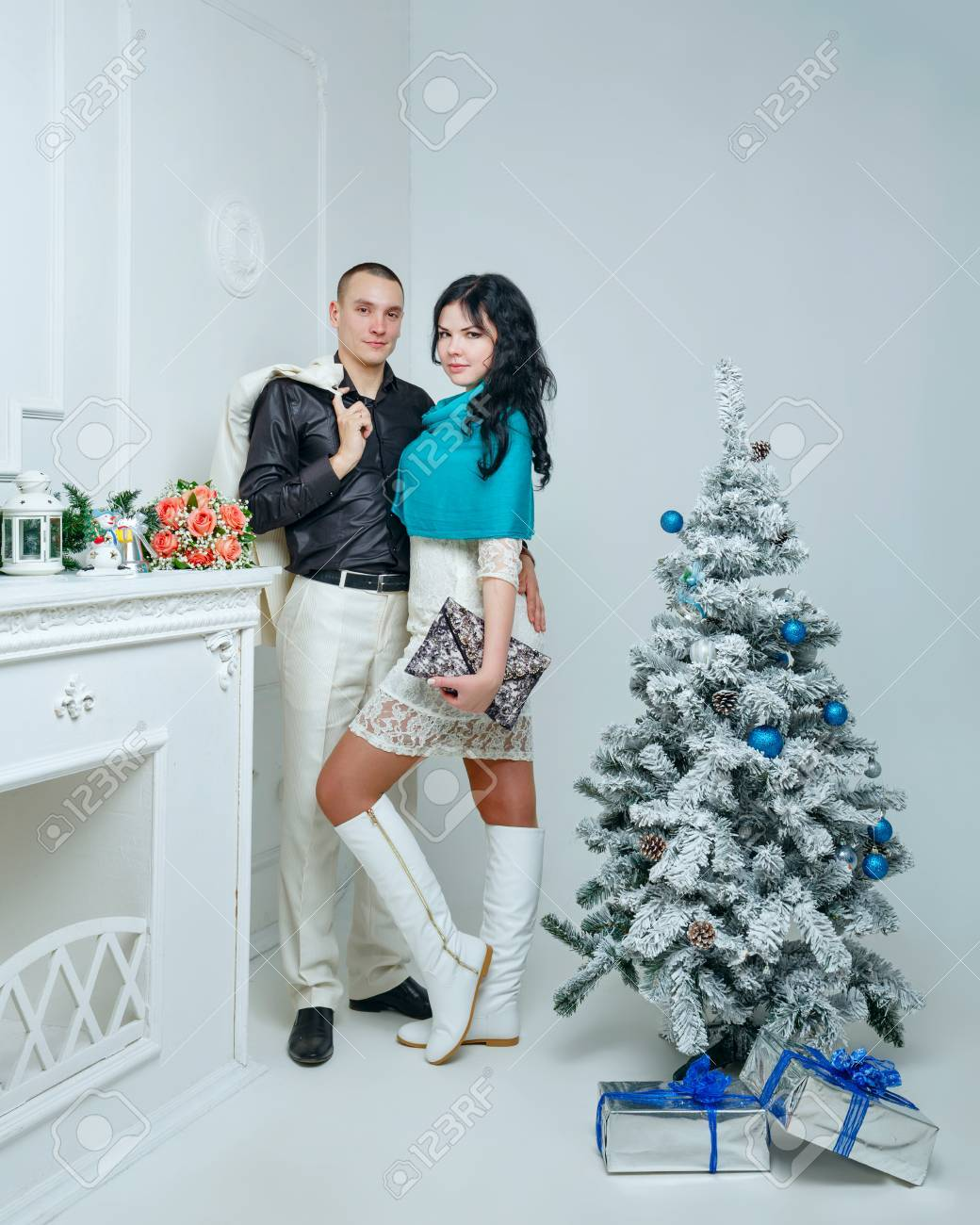 Christmas Gifts For Married Couples Young Part - 20: Stock Photo - Young Loving Married Couple Near Christmas Tree With Gifts
