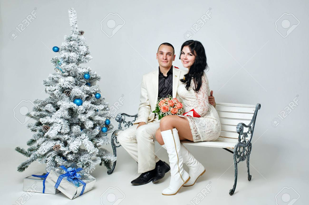 stock photo young loving married couple near christmas tree with gifts
