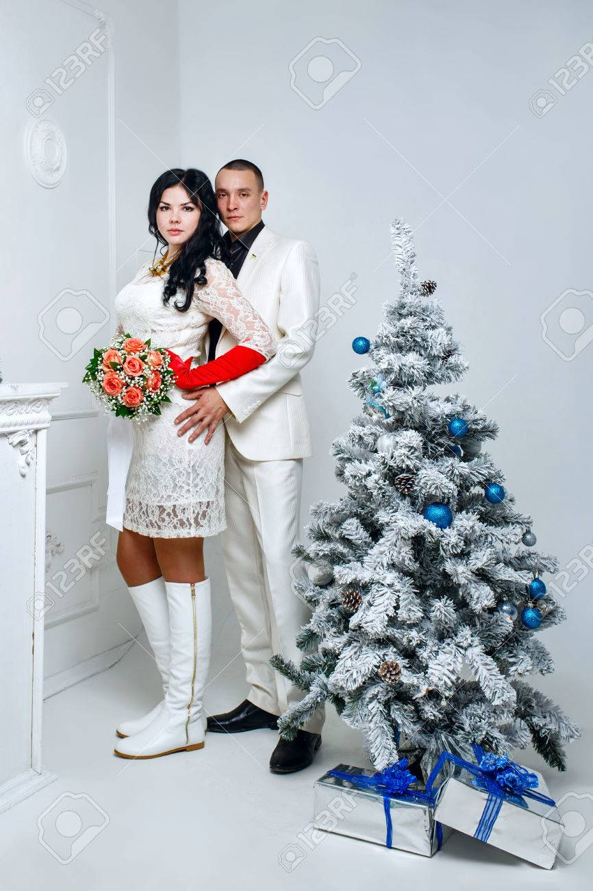 Superior Christmas Gifts For Married Couples Young Part - 10: Young Loving Married Couple Near Christmas Tree With Gifts Stock Photo -  24498092