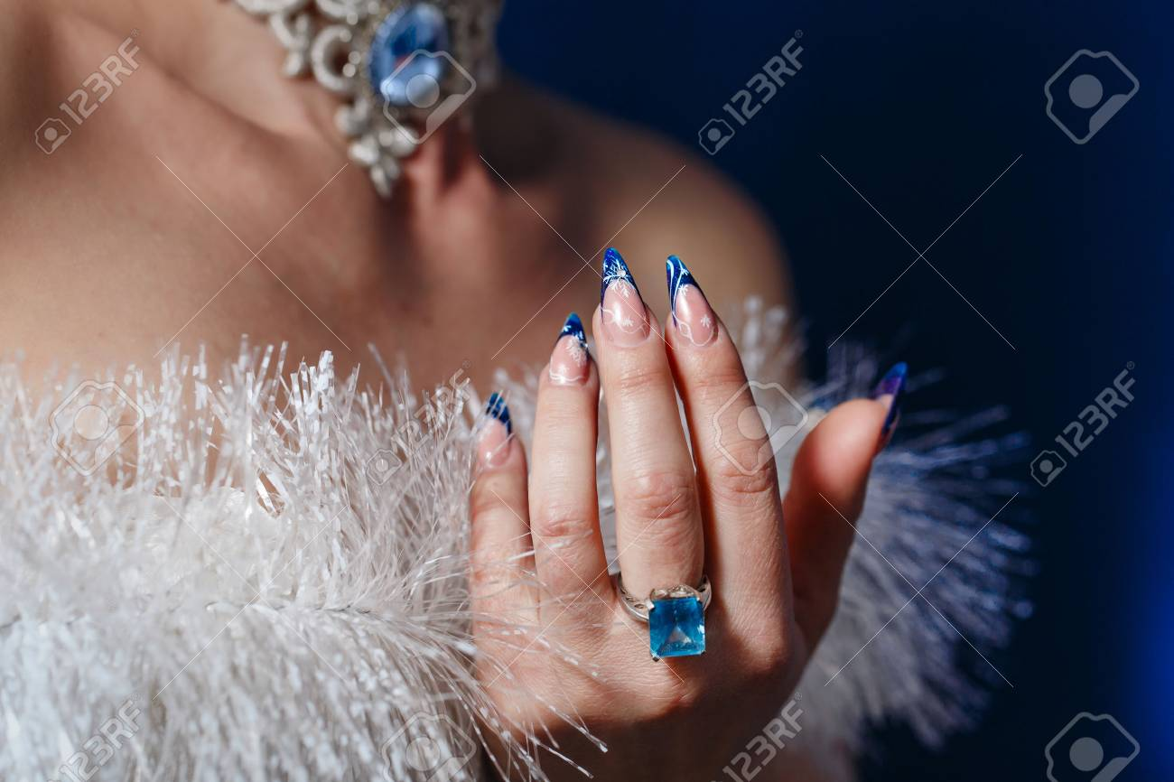 Crack Nail Polish On Female Fingers And Beautiful Jewels Shot ...