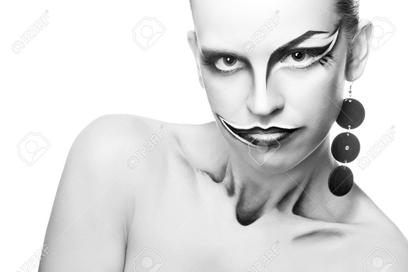 Stock photo young girl with an unusual make up joker clown close up portrait in black and white style