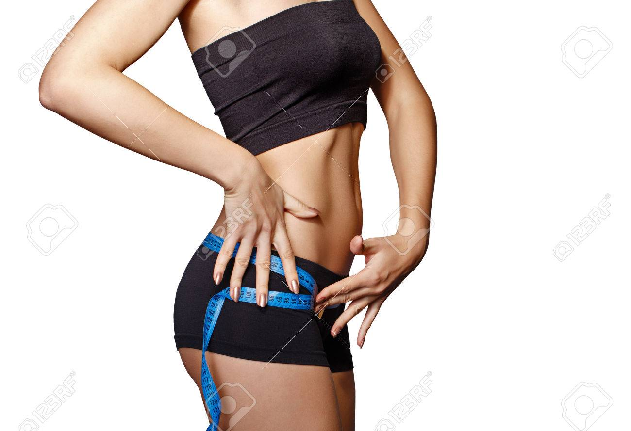 Woman measuring perfect shape of beautiful hips. Healthy lifestyles concept. Sports lifestyle. - 36659779
