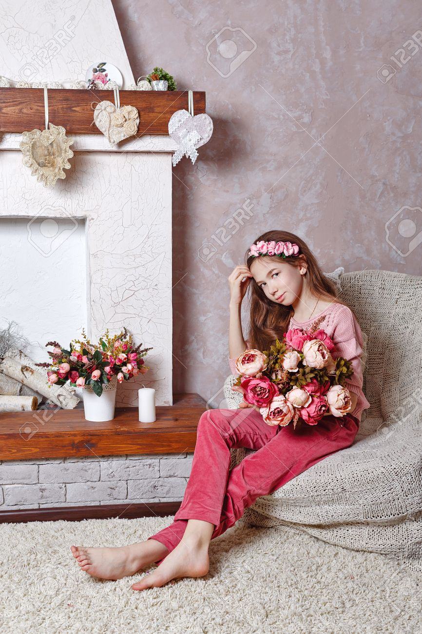 beautiful teen with a bouquet of spring flowers in home