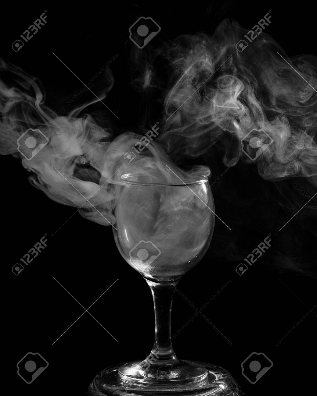 Abstract art  Hookah smoke into cocktail glass on a black background