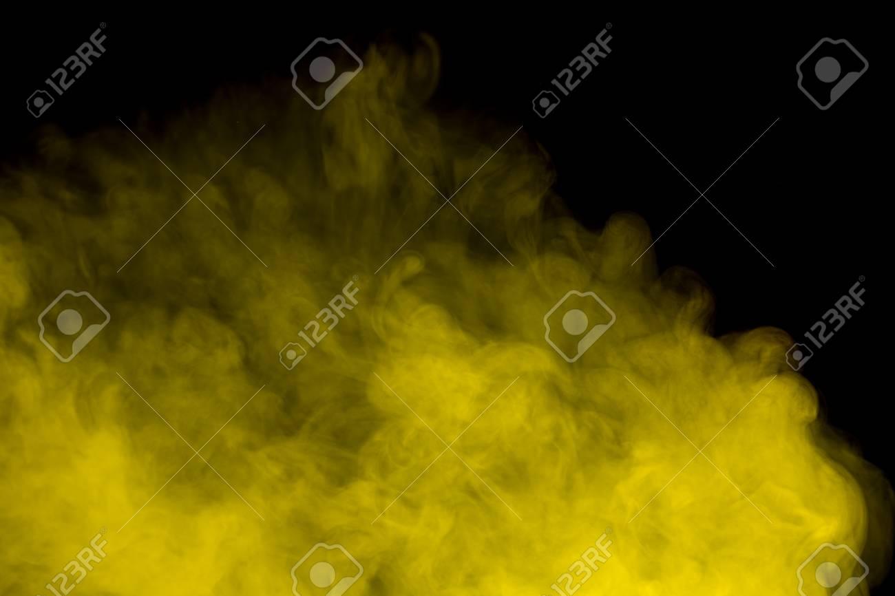 Abstract art  Yellow smoke hookah on a black background  Inhalation