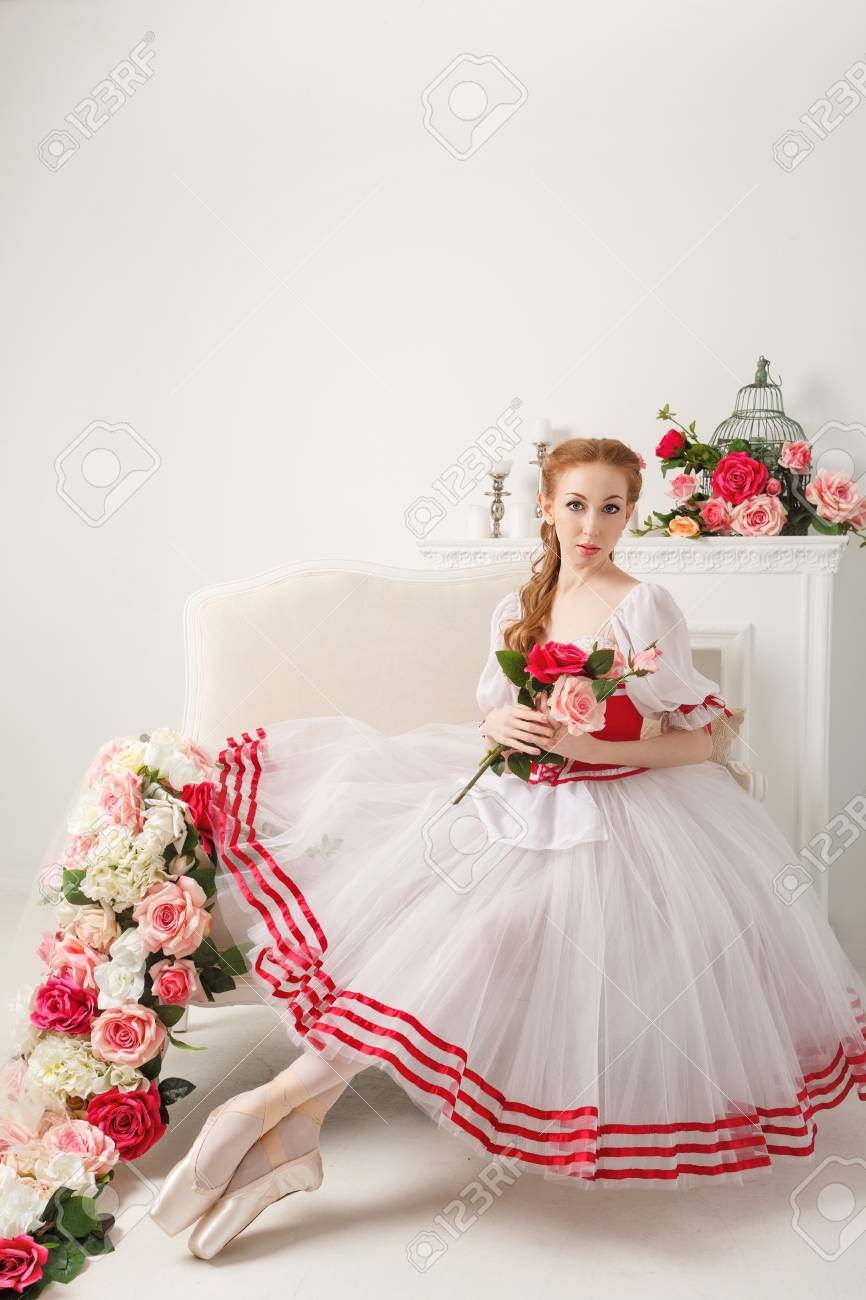 7c34f5dfe7ef Cute ballerina in stage costume, holding a bouquet of spring flowers. Retro  dress.