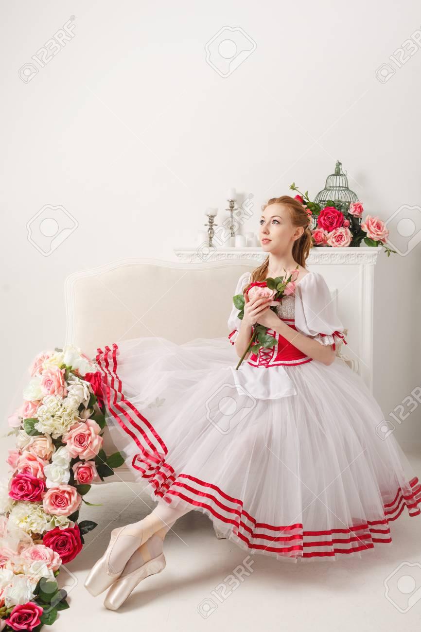 Pretty ballerina in stage costume holding a bouquet of spring pretty ballerina in stage costume holding a bouquet of spring flowers retro dress izmirmasajfo